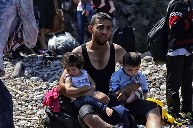 Fotoğraflarla hedefe ulaşan sığınmacıların sevinci galerisi resim 7