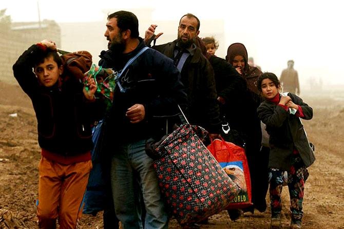 Kum fırtınasına rağmen Musul'dan kaçış galerisi resim 12