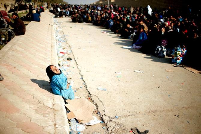 Reuters objektifinden Musul'dan kaçış galerisi resim 1