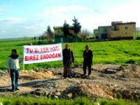Erdoğan Kürtçe pankartla karşılandı