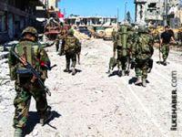İran, Suriye'ye asker iddialarını yalanladı